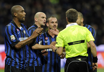 MILAN, ITALY - MAY 06:  (L-F) Maicon, Esteban Cambiasso, Wesley Sneijder of FC Inter Milan and referee Nicola Rizzoli before the Serie A match between FC Internazionale Milano and AC Milan at Stadio Giuseppe Meazza on May 6, 2012 in Milan, Italy.  (Photo