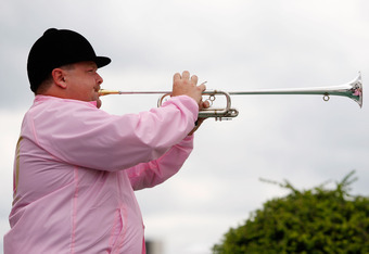 LOUISVILLE, KY - MAY 01:  Churchill Downs� bugler Steve Buttleman plays 'Call to the Post' prior to a race on May 1, 2009 at Churchill Downs in Louisville, Kentucky.  (Photo by Jamie Squire/Getty Images)