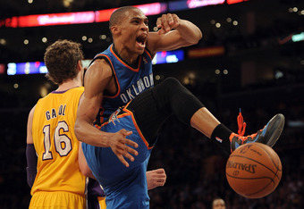 LOS ANGELES, CA - MARCH 29:  Russell Westbrook #0 of the Oklahoma City Thunder reacts after his dunk in front of Pau Gasol #16 of the Los Angeles Lakers during a 102-93 win over the Los Angeles Lakers at Staples Center on March 29, 2012 in Los Angeles, Ca