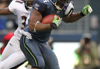 SEATTLE - NOVEMBER 13:  Running back Marshawn Lynch #24 of the Seattle Seahawks rushes against Bernard Pollard #31 of the Baltimore Ravens at CenturyLink Field on November 13, 2011 in Seattle, Washington. The Seahawks defeated the Ravens 22-17. (Photo by