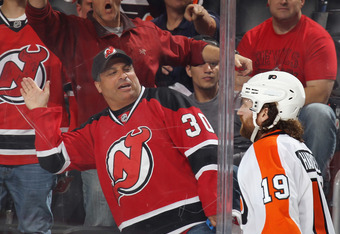 NEWARK, NJ - MAY 06: The New Jersey Devils fans give Scott Hartnell #19 of the Philadelphia Flyers a rough time at the end of the Game Four of the Eastern Conference Semifinals during the 2012 NHL Stanley Cup Playoffs at Prudential Center on May 6, 2012 i