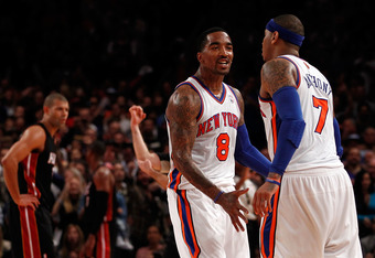 NEW YORK, NY - MAY 06:  J.R. Smith #8 and Carmelo Anthony #7 of the New York Knicks react after Anthony made a 3-point basket to put the Knicks up 87-84 in the fourth quarter as Shane Battier #31 of the Miami Heat lookson dejected in Game Four of the East