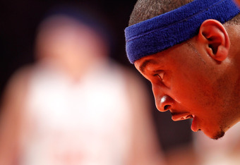 NEW YORK, NY - MAY 03:  Carmelo Anthony #7 of the New York Knicks looks on as a teammate gets set to attempt a free throw against the Miami Heat in the first half of Game Three of the Eastern Conference Quarterfinals in the 2012 NBA Playoffs on May 3, 201