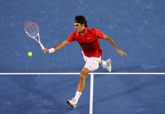MELBOURNE, AUSTRALIA - JANUARY 26:  Roger Federer of Switzerland plays a forehand in his semifinal match against Rafael Nadal of Spain during day eleven of the 2012 Australian Open at Melbourne Park on January 26, 2012 in Melbourne, Australia.  (Photo by