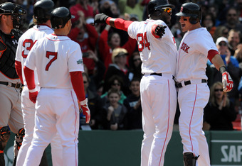 BOSTON, MA - MAY 6: Will Middlebrooks #64 is congratulated by David Ortiz #34, Cody Ross #7, and Jarrod Saltalamacchia #39 after hitting a grand slam in the fifth inning to tie the game against the Baltimore Orioles at Fenway Park May 6, 2012 in Boston, M