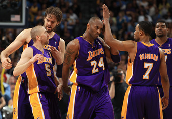 DENVER, CO - MAY 06:  Steve Blake #5, Pau Gasol #16, Kobe Bryant # 24, Ramon Sessions #7 and Andrew Bynum #17 of the Los Angeles Lakers celebrate their victory over the Denver Nuggets in Game Four of the Western Conference Quarterfinals in the 2012 NBA Pl
