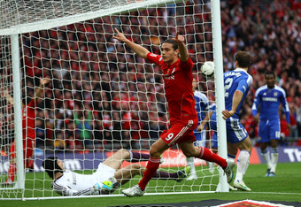 LONDON, ENGLAND - MAY 05: Andy Carroll of Liverpool turns to celebrate a goal that was not given  during the FA Cup with Budweiser Final match between Liverpool and Chelsea at Wembley Stadium on May 5, 2012 in London, England.  (Photo by Clive Brunskill/G