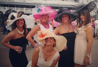 LOUISVILLE, KY - MAY 5: (EDITOR'S NOTE: Image was shot with a cellular phone using Instagram)  A group of women pose for a photo in front of the twin spires during the 138th running of the Kentucky Derby on May 5, 2012 at Churchill Downs in Louisville, Ke