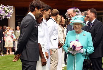 LONDON, ENGLAND - JUNE 24:  Queen Elizabeth II meets (L-R) Roger Federer, Serena Williams, Novak Djokovic, Andy Roddick, Venus Williams and Caroline Wozniacki as she attends the Wimbledon Lawn Tennis Championships on Day 4 at the All England Lawn Tennis a