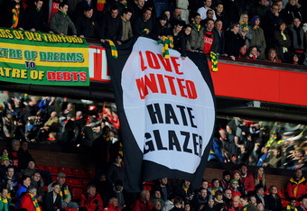 MANCHESTER, ENGLAND - MARCH 14: Manchester United fans unfurl an anti-Glazer banner during the Barclays Premier League match between Manchester United and Fulham at Old Trafford on March 14, 2010 in Manchester, England.  (Photo by Michael Regan/Getty Imag
