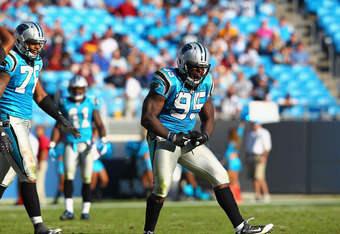CHARLOTTE, NC - OCTOBER 23: Charles Johnson #95 of the Carolina Panthers celebrates a sack against the Washington Redskins at the Bank of America Stadium on October 23, 2011 in Charlotte, North Carolina.  (Photo by Dilip Vishwanat/Getty Images)