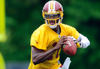 ASHBURN, VA - MAY 06: Robert Griffin III #10 of the Washington Redskins drops back to make a pass during the Washington Redskins rookie minicamp on May 6, 2012 in Ashburn, Virginia. (Photo by Patrick McDermott/Getty Images)