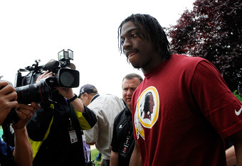 ASHBURN, VA - MAY 06: Robert Griffin III #10 of the Washington Redskins speaks to members of the media after a practice during the Washington Redskins rookie minicamp on May 6, 2012 in Ashburn, Virginia. (Photo by Patrick McDermott/Getty Images)