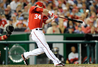 WASHINGTON, DC - MAY 06:  Bryce Harper #34 of the Washington Nationals hits a double in the eighth inning against the Philadelphia Phillies at Nationals Park on May 6, 2012 in Washington, DC.  (Photo by Greg Fiume/Getty Images)
