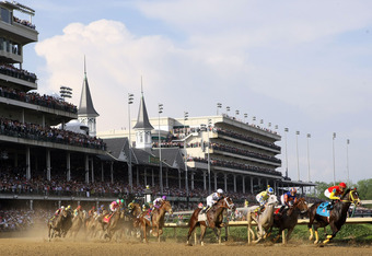 LOUISVILLE, KY - MAY 05:  Dullahan ridden by Kent Desormeaux leads the field around the first turn during the 138th running of the Kentucky Derby at Churchill Downs on May 5, 2012 in Louisville, Kentucky.  (Photo by Elsa/Getty Images)