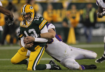 GREEN BAY, WI - NOVEMBER 14:  Jared Allen #69 of the Minnesota Vikings tackles Aaron Rodgers #12 of the Green Bay Packers at Lambeau Field on November 14, 2011 in Green Bay, Wisconsin. The Packers defeated the Vikings 45-7.  (Photo by Jonathan Daniel/Gett
