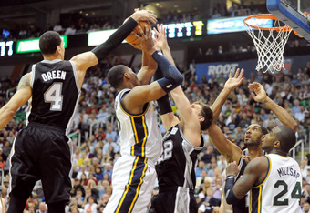 SALT LAKE CITY, UT  - MAY 5: Daniel Green #4 of the San Antonio Spurs blocks the shot of Derrick Favors #15 of the Utah Jazz during the fourth quarter of Game Three of the Western Conference Quarterfinals in the 2012 NBA Playoffs at EnergySolutions Arena