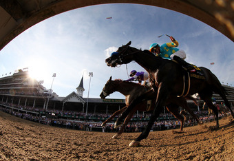 LOUISVILLE, KY - MAY 05:  Mario Gutierrez (L) comes down the final stretch atop I'll Have Another ahead of Bodemeister ridden by Mike Smith during the 138th running of the Kentucky Derby ahead of at Churchill Downs on May 5, 2012 in Louisville, Kentucky.