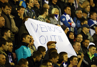 WIGAN, ENGLAND - NOVEMBER 19:  Blackburn fans protest against the owners Venky's and manager Steve Kean during the Barclays Premier League match between Wigan Athletic and Blackburn Rovers at the DW Stadium on November 19, 2011 in Wigan, England.  (Photo