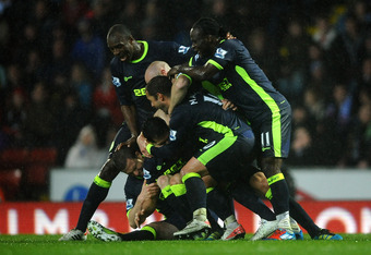 BLACKBURN, ENGLAND - MAY 07:   Antolin Alcaraz of Wigan Athletic is mobbed by his team mates aftyer scoring the winning goal during the Barclays Premier League match between Blackburn Rovers and Wigan Athletic at Ewood Park on May 7, 2012 in Blackburn, En