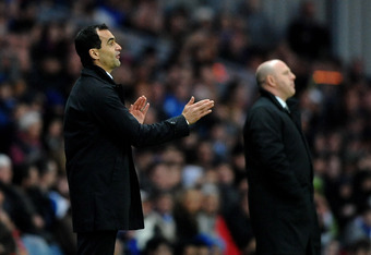 BLACKBURN, ENGLAND - MAY 07:  Wigan Manager Roberto Martinez (L) gestures during the Barclays Premier League match between Blackburn Rovers and Wigan Athletic at Ewood Park on May 7, 2012 in Blackburn, England.  (Photo by Laurence Griffiths/Getty Images)