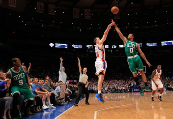 NEW YORK, NY - APRIL 17: Steve Novak #16 of the New York Knicks shoots against Avery Bradley #0 of the Boston Celtics at Madison Square Garden on April 17, 2012 in New York City. NOTE TO USER: User expressly acknowledges and agrees that, by downloading an