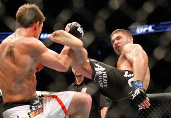 MONTREAL- MAY 8: Jeremy Stephens (R) kicks Sam Stout in their lightweight 'swing' bout at UFC 113 at Bell Centre on May 8, 2010 in Montreal, Quebec, Canada.  (Photo by Richard Wolowicz/Getty Images)