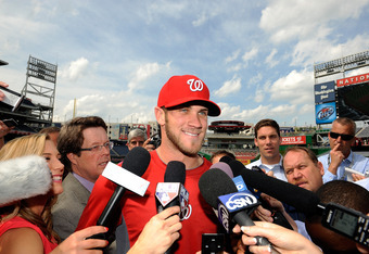 WASHINGTON, DC - MAY 01:  Bryce Harper #34 of the Washington Nationals talks to the media before the game against the Arizona Diamondbacks at Nationals Park on May 1, 2012 in Washington, DC.  (Photo by Greg Fiume/Getty Images)