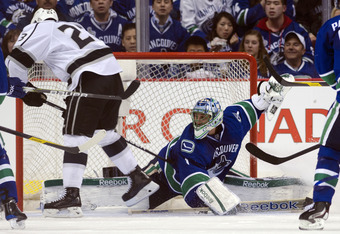 VANCOUVER, CANADA - APRIL 11: Roberto Luongo #1 of the Vancouver Canucks streches to make a save against Dustin Brown #23 of the Los Angeles Kings during the second period in Game One of the Western Conference Quarterfinals during the 2012 NHL Stanley Cup