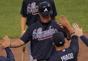 Chipper Jones and the Braves brought out the heavy lumber Saturday night at Coors Field.
