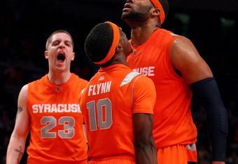 Orange celebrates six OT win over UConn in Big East tourney. it won't happen again.