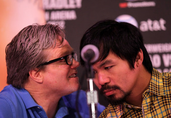 BEVERLY HILLS, CA - FEBRUARY 21:  Trainer Freddie Roach talks with Manny Pacquiao at a press conference announcing Pacquiao's upcoming World Boxing Organization welterweight championship fight against Timothy Bradley at The Beverly Hills Hotel on February