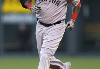 Big Papi rounds the bases after his home run on Monday night, his seventh of the season.