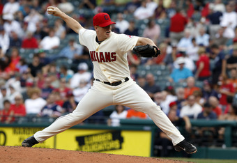 CLEVELAND, OH - SEPTEMBER 25: Vinnie Pestano #52 of the Cleveland Indians pitches against the Minnesota Twins during the seventh inning of their game on September 25, 2011 at Progressive Field in Cleveland, Ohio. The Twins defeated theIndians 6-4. (Photo