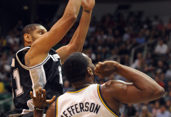 SALT LAKE CITY, UT - MAY 7: Tim Duncan #21 of the San Antonio Spurs shoots the ball over Al Jefferson #25 of the Utah Jazz during the first quarter of Game Four of the Western Conference Quarterfinals in the 2012 NBA Playoffs at EnergySolutions Arena on M