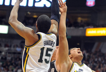 SALT LAKE CITY, UT  - MAY 5: Derrick Favors #15 and Enes Kanter #0 of the Utah Jazz go after a rebound against Tiago Splitter #22 of the San Antonio Spurs during the first quarter of Game Three of the Western Conference Quarterfinals in the 2012 NBA Playo