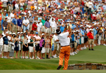 CHARLOTTE, NC - MAY 05:  Phil Mickelson of the United States hits an approach shot on the 18th hole during the third round of the Wells Fargo Championship at the Quail Hollow Club on May 5, 2012 in Charlotte, North Carolina.  (Photo by Streeter Lecka/Gett