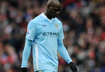 LONDON, ENGLAND - APRIL 08:  Mario Balotelli of Man City walks dejected during the Barclays Premier League match between Arsenal and Manchester City at Emirates Stadium on April 8, 2012 in London, England.  (Photo by Michael Regan/Getty Images)