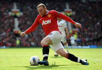 MANCHESTER, ENGLAND - MAY 06:  Wayne Rooney of Manchester United in action during the Barclays Premier League match between Manchester United and Swansea City at Old Trafford on 6 May 2012 in Manchester, England.  (Photo by Laurence Griffiths/Getty Images