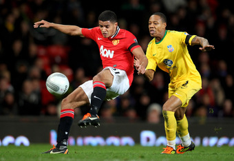 MANCHESTER, ENGLAND - NOVEMBER 30:  Nathaniel Clyne of Crystal Palace competes with Ezekiel Fryers of Manchester United during the Carling Cup Quarter Final match between Manchester United and Crystal Palace at Old Trafford on November 30, 2011 in Manches