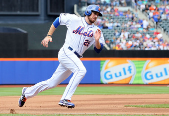 NEW YORK, NY - MAY 06: Ike Davis #29 of the New York Mets rounds third base to score a fourth inning run against the Arizona Diamondbacks at Citi Field on May 6, 2012 in the Flushing neighborhood of the Queens borough of New York City. (Photo by Jim McIsa