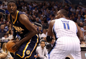 ORLANDO, FL - MAY 05:  Center Roy Hibbert #55 of the Indiana Pacers is defended by Center Glen Davis #11 of the Orlando Magic in Game four of the Eastern Conference Quarterfinals in the 2012 NBA Playoffs at Amway Center on May 5, 2012 in Orlando, Florida.