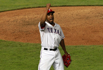 ARLINGTON, TX - OCTOBER 24: Neftali Feliz #30 of the Texas Rangers celebrates after defeating the St. Louis Cardinals 4-2 during Game Five of the MLB World Series at Rangers Ballpark in Arlington on October 24, 2011 in Arlington, Texas.  (Photo by Ronald