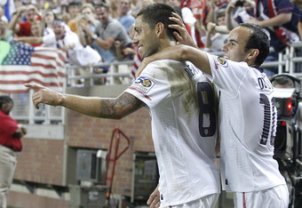 DETROIT, MI - JUNE 7: Clint Dempsey #8 of the United States celebrates a second half goal with Landon Donovan #10 while playing Canada during the 2011 Gold Cup  at Ford Field on June 7, 2011 in Detroit, Michigan. The United States won the game 2-0. (Photo