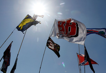 TALLADEGA, AL - APRIL 17:  Fan Flags wave in the wind in the infield during the NASCAR Sprint Cup Series Aaron's 499 at Talladega Superspeedway on April 17, 2011 in Talladega, Alabama.  (Photo by Jason Smith/Getty Images for NASCAR)