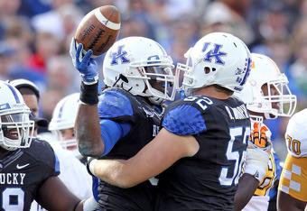 Kentucky defensive end Collins Ukwu (left)