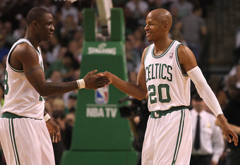 BOSTON, MA - MAY 04:  Ray Allen #20 of the Boston Celtics smiles with Mickael Pietrus #28 of the Boston Celtics at the end of the first quarter during a game with the Atlanta Hawks in Game Three of the Eastern Conference Quarterfinals during the 2012 NBA
