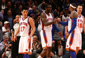NEW YORK, NY - MARCH 20:  (L-R) Jeremy Lin #17, Amare Stoudemire #1, Carmelo Anthony #7 and Steve Novak #16 of the New York Knicks celebrate in the second half against the Toronto Raptors at Madison Square Garden on March 20, 2012 in New York City.  NOTE