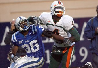 DURHAM, NC - OCTOBER 18:  Aldarius Johnson #4 of the Miami Hurricanes looks to make the reception against Lee Butler #36 of the Duke Blue Devils during the game at Wallace Wade Stadium on October 18, 2008 in Durham, North Carolina.  (Photo by Kevin C. Cox