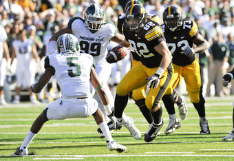 IOWA CITY, IA - OCTOBER 30: Tight end Allen Reisner #82 of the University of Iowa Hawkeyes runs the ball as corner back Johnny Adams #5 of the Michigan State Spartans defends during the first half of play at Kinnick Stadium on October 30, 2010 in Iowa Cit